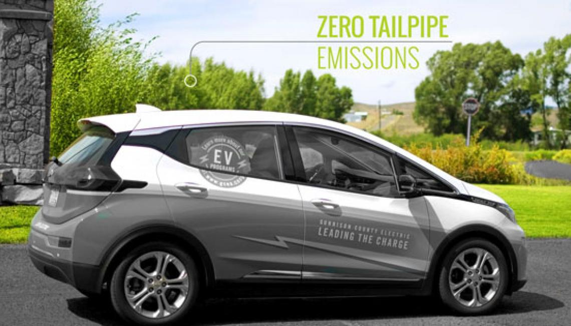 "EV driving with text saying ""Zero Tailpipe Emissions"""